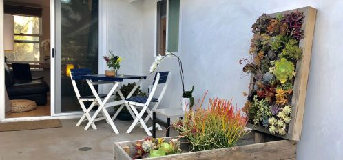 Outdoor patio at The Inn at Moonlight Beach, the perfect place to stay during Del Mar horse racing season