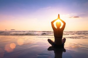 Beach yoga, one of the best spiritual wellness activities
