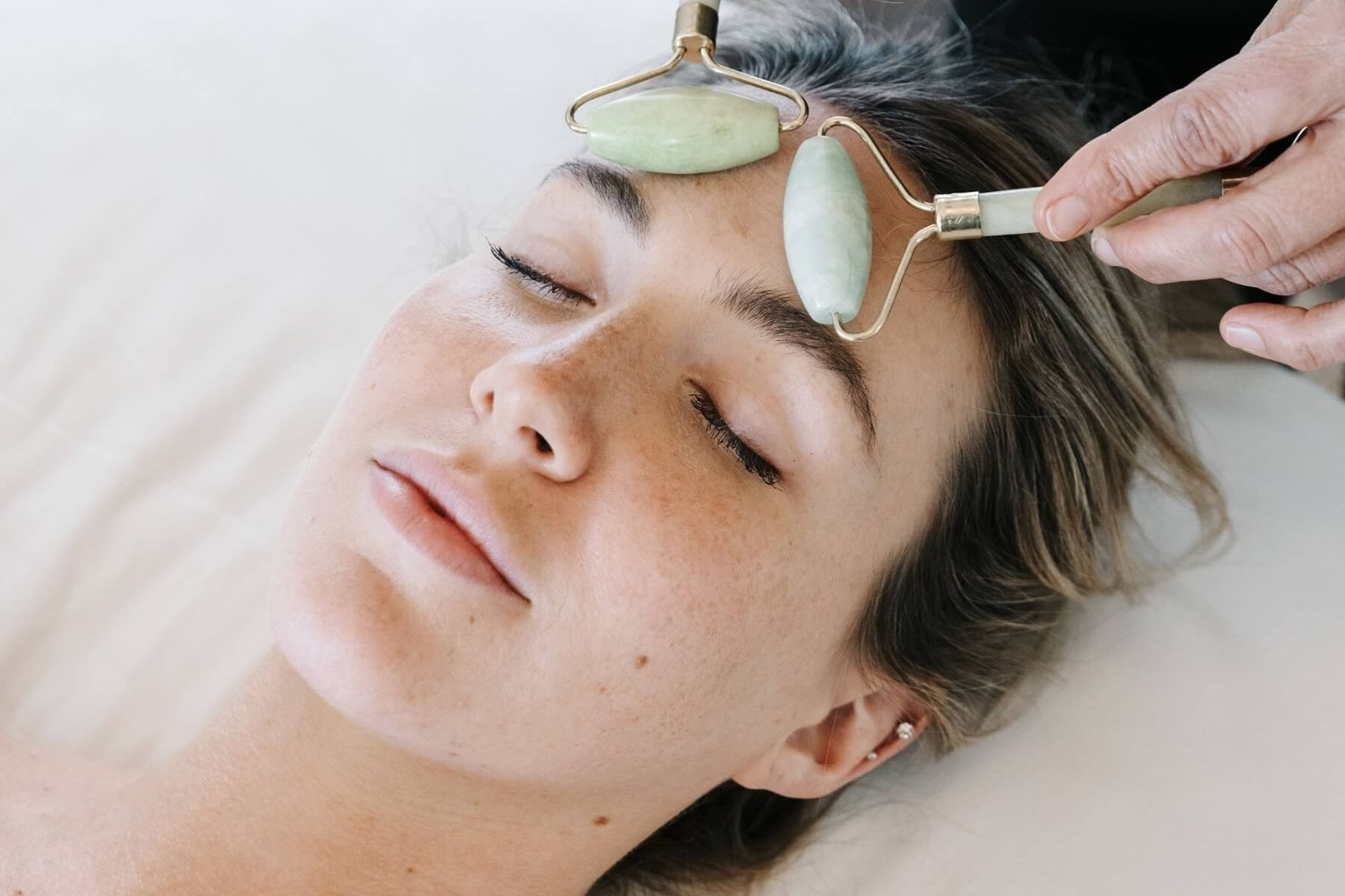 facial with glass rollers